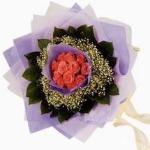 12 adet gül ve elyaflardan   Sivas çiçek , çiçekçi , çiçekçilik